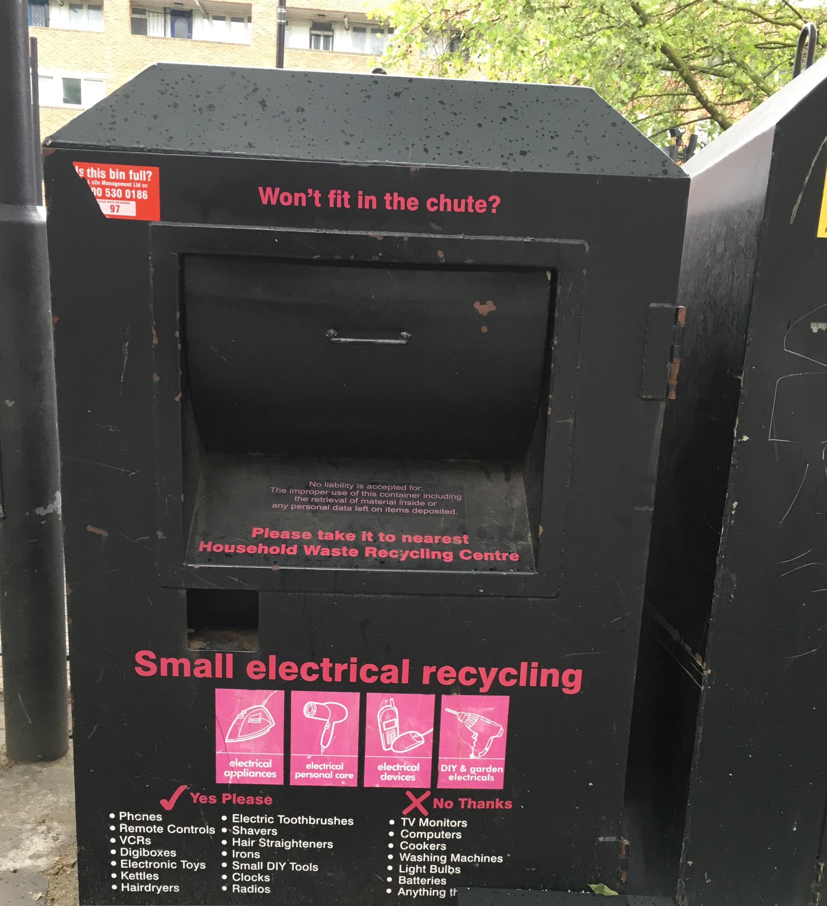 Black metal box for throwing away small electric devices.
